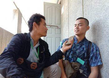 Salah seorang mahasiswa baru Unand saat diwawancarai di Gedung C Unand, Senin (12/8/2019). (Foto: Indah Ariesta Gusra)